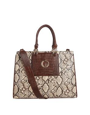 Handtassen van het merk Caroline Biss in het Beige